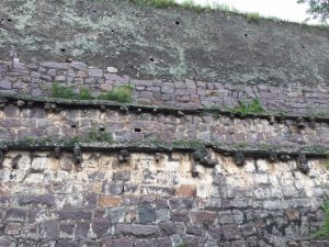 Fort wall showing where the clay pipes were that transported water from lower to higher tanks.